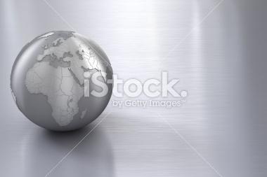 Srebrny glob na stalowej powierzchni - Stock Image